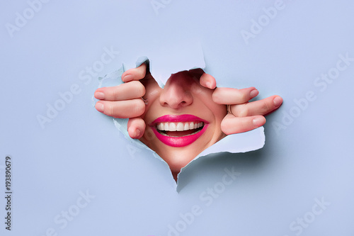 Carta da parati close-up of female fingers, nose and lips with pink lipstick and a broad smile t