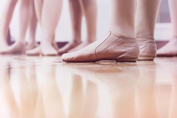 Dancers in Jazz shoes standing in the studio classroom