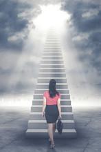 Businesswoman Walking Up Stair...