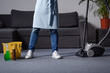 cropped image of man standing with vacuum cleaner