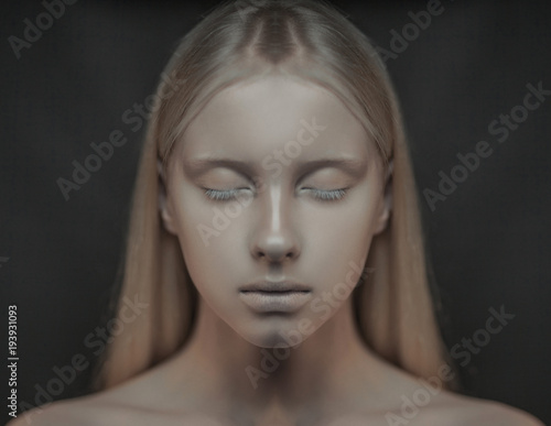 Portrait of young albino woman with closed eyes. Canvas Print