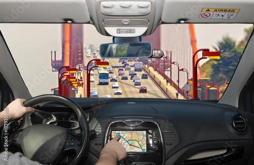 Driving using navigation system, Golden Gate Bridge, San Francisco, USA Poster