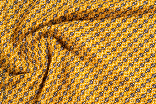 Photo  Fabric cotton is brown with a pattern of circles