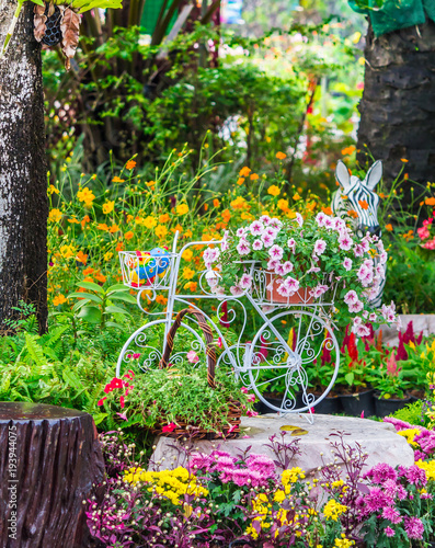 Aluminium Prints Bicycle In cozy home garden on summer./ Vintage white bike and flowerpot in cozy home flowers garden on summer.