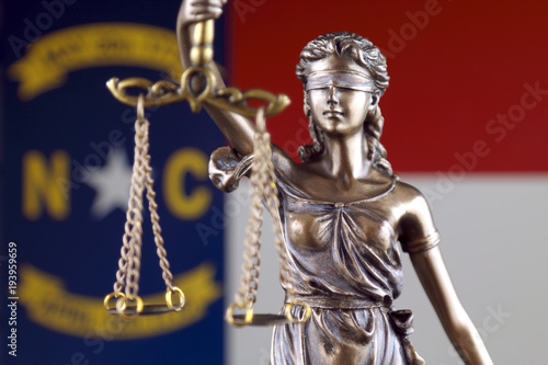 Symbol Of Law And Justice With North Carolina Flag Close Up Buy