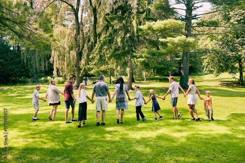 Fototapeta Rear view of happy family of eleven walking obraz