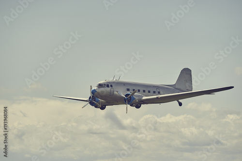 Photo  Old propeller airliner flying