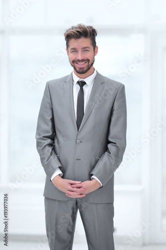 Fototapety, obrazy: A young man in a gray suit