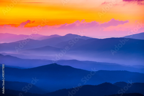quiet mountain valley in a blue mist at the sunset #193977810