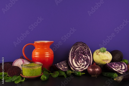 Poster  Assortment of raw organic purple and green vegetables.