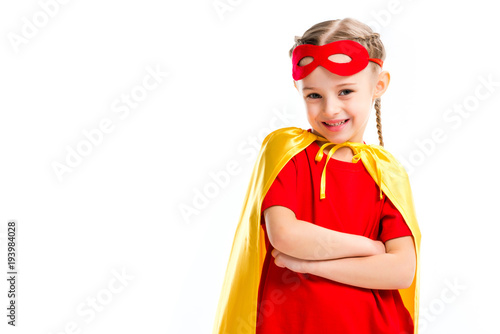 Photo  Excited little supergirl wearing yellow cape with red mask for eyes on forehead