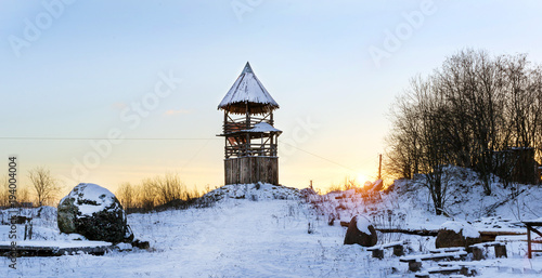 Fotografiet  Wooden lookout tower stands on a snowy mountain