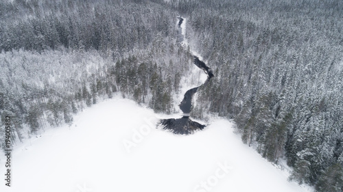 In de dag Luchtfoto Aerial view of river and boreal forest covered by snow