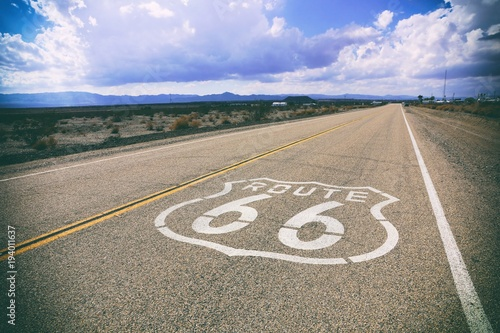 Keuken foto achterwand Route 66 Famous Route 66 road marker on a California highway, USA. Vintage styling.