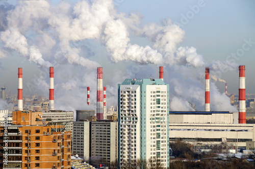 Smoking chimneys of the combined heat and power plant. Akademichesky district, Moscow, Russia