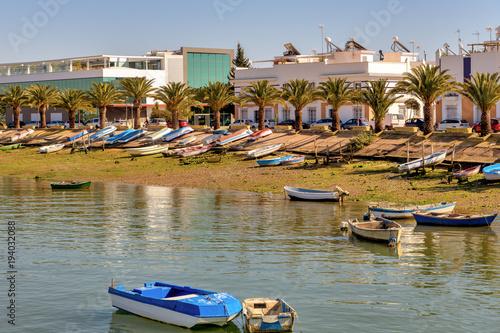 Colorful boats ashore next to Carreras river in Isla Cristina, Huelva, Spain.