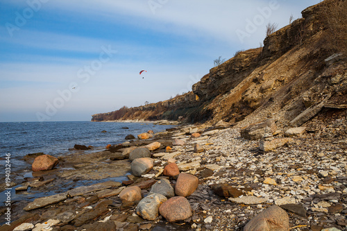 Staande foto Kust Baltic sea, steep limestone coast (cliff). Early spring, Estonia.