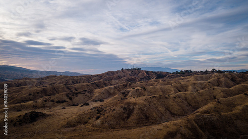 Fotobehang Diepbruine Aerial drone view of a landscape with desert and mountains