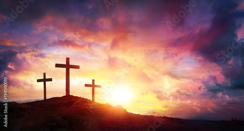 Foto op Plexiglas Zonsondergang Crucifixion Of Jesus Christ At Sunrise - Three Crosses On Hill