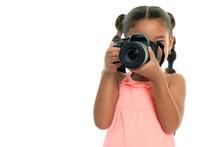 Multiracial Small Girl Taking ...