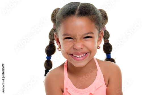 Photo Cute multiracial small girl smiling  - Isolated on white