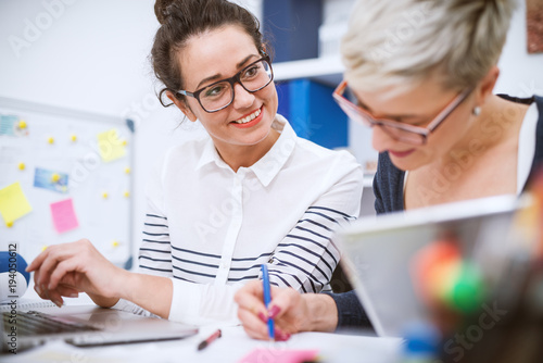 Fototapety, obrazy: Portrait of professional middle aged women working together on projects in the office.
