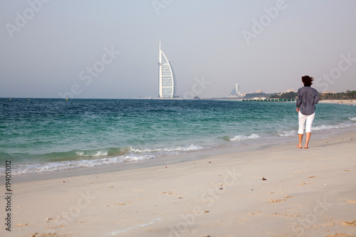 Photo  DUBAI, UNITED ARAB EMIRATES - FEBRUARY 2018 : Burj Al Arab, One of the most famous landmarks of United Arab Emirates seen from Black Palace public beach