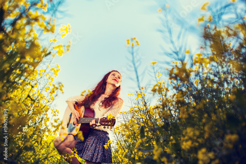 Poster  Young ginger hair girl in 70s style with acoustic guitar