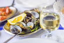 Clams Served On Silverware With White Wine