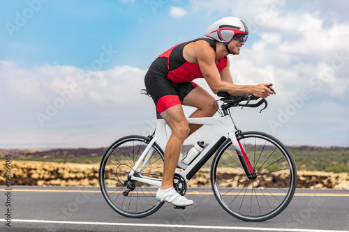 Aluminium Prints Cycling Triathlon cyclist man cycling racing on road bike on ironman competition racing against time. Triathlete training bicycle workout for triathlon race.