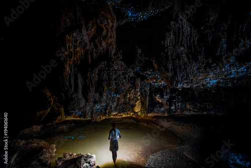 Woman standing in cave full of New Zealand glow worms Canvas Print