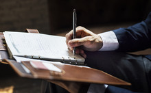Businessman Writing A Note
