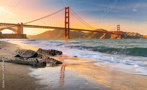 Sunset at the beach by the Golden Gate Bridge in San Francisco California