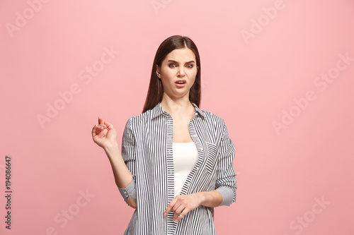 Fotografija  Young woman with disgusted expression repulsing something, isolated on the pink