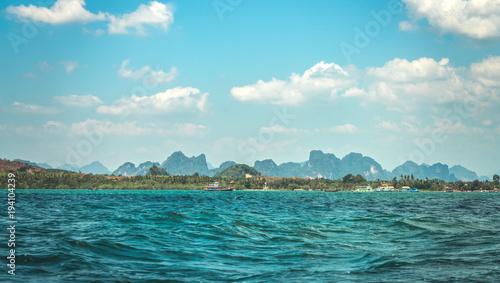 Boat sailing in green ocean