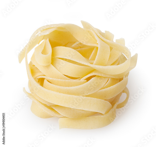 Uncooked nest of tagliatelle pasta isolated on white background with clipping pa Fototapeta