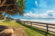 COOLUM, AUSTRALIA, FEB 18 2018: People enjoying summer at Coolum main beach - famous tourist destination in Queensland, Australia.