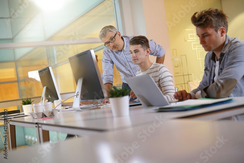 Students in apprenticeship attending computing class Canvas Print