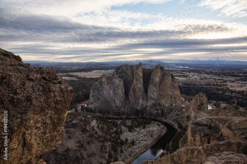 Staande foto Grijze traf. Striking landscape of the famous location, Smith Rock, during a winter cloudy evening. Taken in Oregon, United States of America.