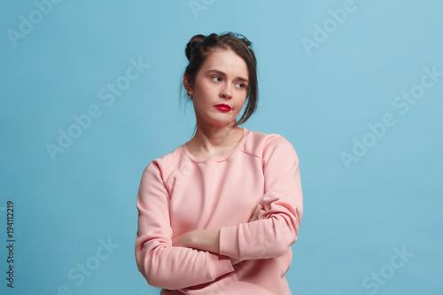 Fotografie, Obraz  Beautiful bored woman bored isolated on blue background
