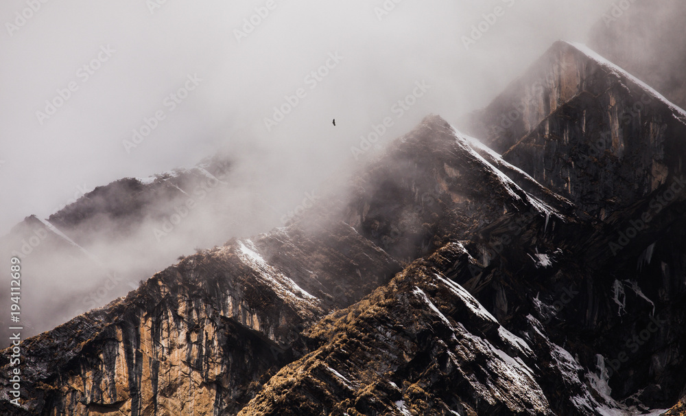 Fototapeta Majestical mountains in clouds in Nepal. Landscape with beautiful high rocks and dramatic cloudy sky. Nature background. Fairy scene. Amazing mountains