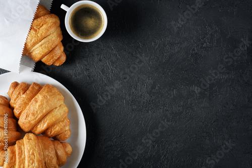 Fotografie, Obraz  Croissants and coffee on a dark background. Breakfast flat lay.