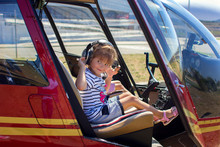 The Girl Sits At A Helicopter ...