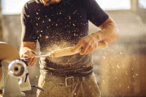 Slika na platnu wood lathe, lathe operator working a wood pestle