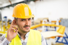 Factory Worker Making Can't Hear You Because Of Noise Gesture.