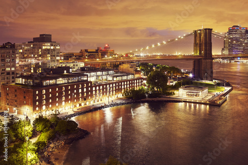Photo  Dumbo neighborhood and the Brooklyn Bridge at night, color toned picture, New York City, USA