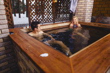 Beautiful Couple In The Hot Tub In The Winter