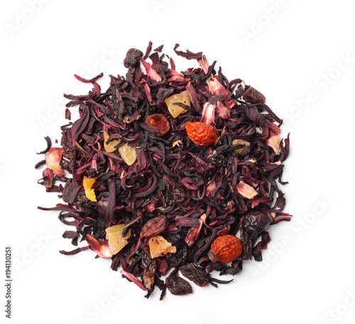 Top view of organic herbal tea with fruits and flowers