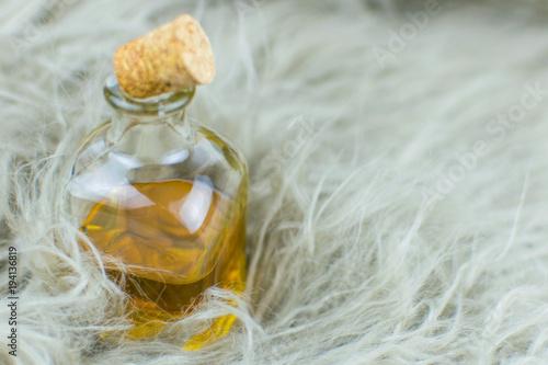 Fototapeta Bottle with elixir on the background of fur. obraz
