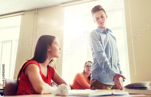 Fotografie, Obraz  students gossiping behind classmate back at school
